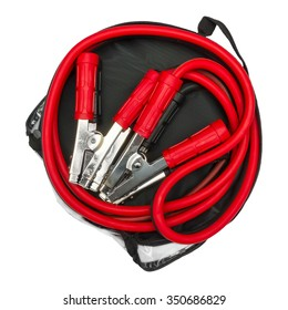 Red and black jumper cables in bag isolated on a white background. Top view.