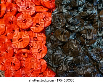Red and Black Liquorice Candy Background Texture
