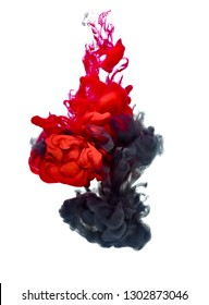 red and black paint in water