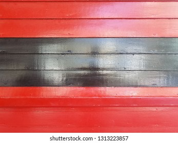 red and black painted wood wall or background