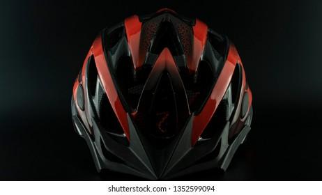 red black patterned bicycle helmet