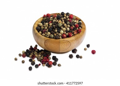 Red and black pepper seeds in wooden bowl isolated on white