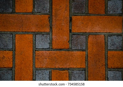 Red and black square brick wall in design, abstract pattern.