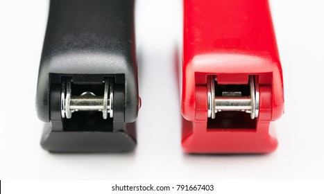 red and black staplers from the back point of view.