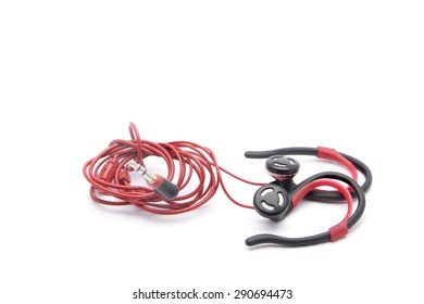 Red And Black Twisted Headphones On Simple White Background