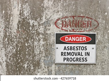 red, black and white Danger, Asbestos Removal in Progress warning sign