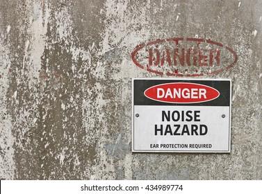 red, black and white Danger, Noise Hazard warning sign