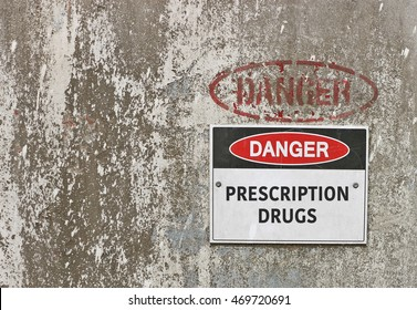 red, black and white Danger, Prescription Drugs warning sign