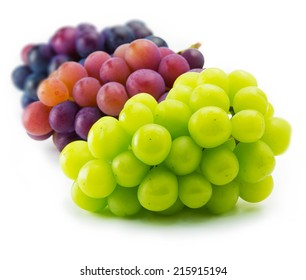 red, black and white (green) grapes isolated on white.