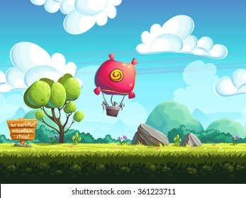 Red blimp flying over a green meadow with trees and rocks on the background of distant mountains in blue haze heaven with fluffy white clouds