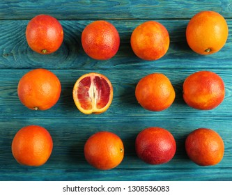 Red blood oranges on a blue wooden table