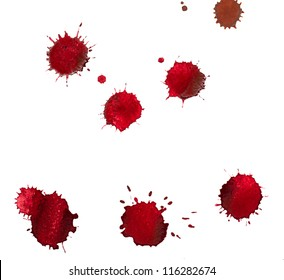 Red blots of watercolor paint
