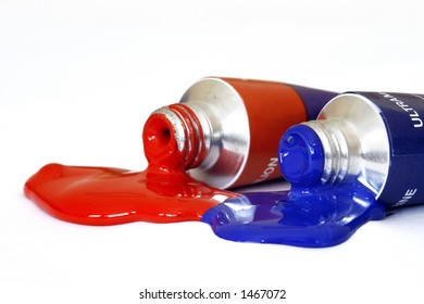 Red and blue acrylic paint pouring from a tube. Colour can be easily changed to any colour using hue/saturation in photo package