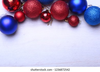 Red and blue christmas balls on a wooden background