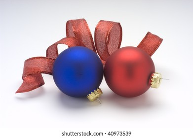 Red and blue Christmas ornaments with red ribbon.