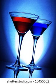 Red and blue cocktails on blue background