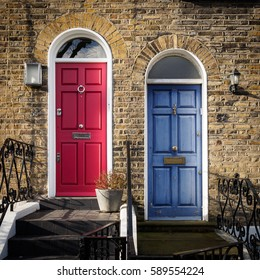 Red and Blue doors in London of a terrace georgian house
