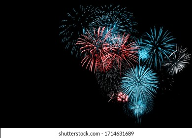 Red and Blue Fireworks on Black background