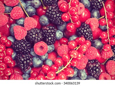 Red and blue fruit mix. Toned filtered image in instagram style