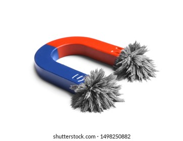 Red and blue horseshoe magnet with iron filings on white background