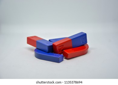 "Red and blue magnet. There are difference poles but There need each other like ""Men and Women""."