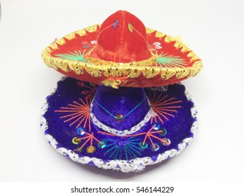 Red and blue Mexican Mariachi hat on white background .