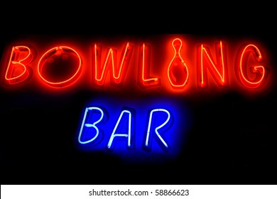 Red and blue neon sign of the words 'Bowling bar' on a black background.
