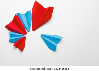 Red and blue paper planes on white background. Leadership and Business competition concepts