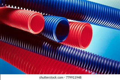 red and blue plastic tubes on light blue background