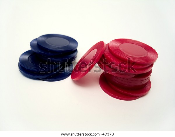 Red and blue poker chips stacked together on a white background.