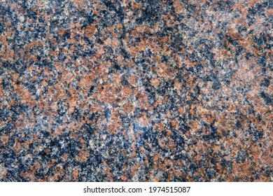 Red and blue polished granite wall background. Honed granite slab texture. Abstract stone backdrop with copy space.