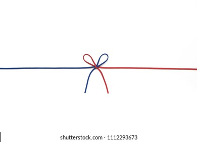red and blue ribbon isolated on white background. two colors chamois string tied in a bow. colorful threads.