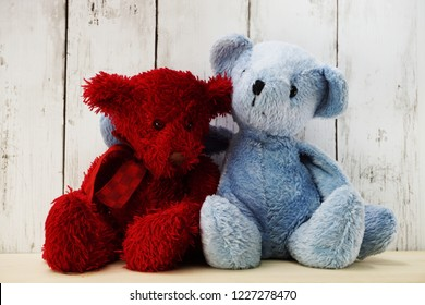 red and blue teddy bear hugging each other love and relationship concept