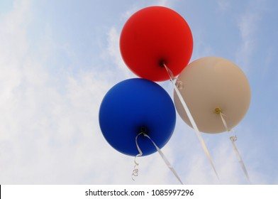 Red blue and white balloon in the sky