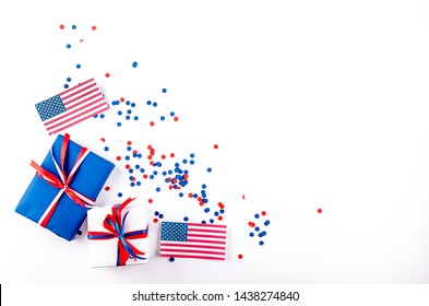 red, blue and white gift boxes on a white background in the national colors of America, Russia or England, the concept of Independence Day, a national holiday,