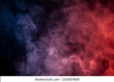 Red, blue and white smoke on black background