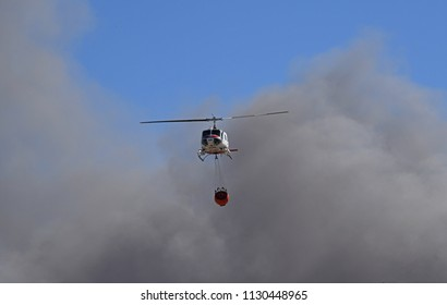 Red Bluff, California, USA - June 23 2018: CalFire Helicopter Coming from a Wildfire Near Red Bluff, California, to the Sacramento River to Load Water
