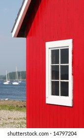 Red Boat House On Maine Bay