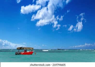 Red boat on azure water of Caribbean Sea