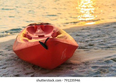 Red boat is on sandy sunset beach, Maldives