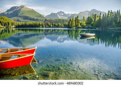 Red boat on Tarn Strbske pleso at Slovakia. High Tatras mountains