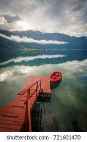 Red boat with reflection in Norway