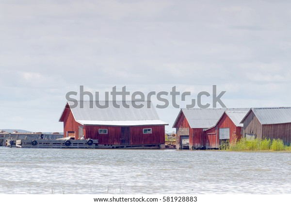 Red boathouses, bridge and sea in the archipelago in Aland, Finland