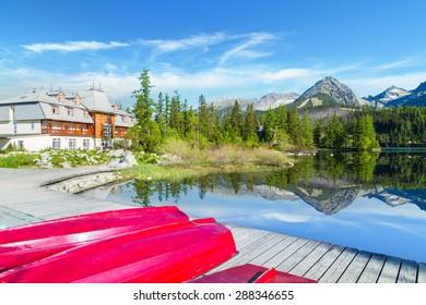 Red boats on the pier near Strbske Pleso lake, Slovakia