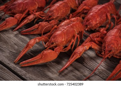 Red boiled crayfish on wooden background