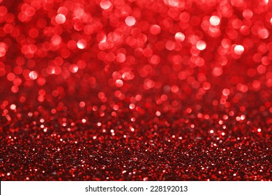 Red bokeh holiday textured glitter background