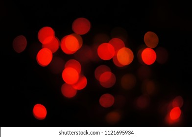 red bokeh on black background