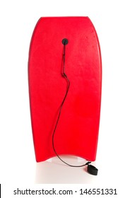 A red boogie board on a white background