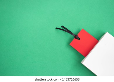 Red bookmark and a white book on a green background