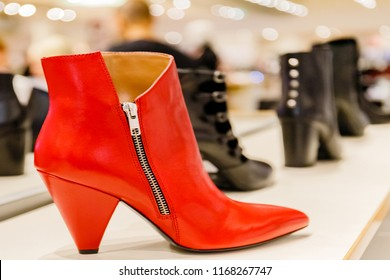 Red boot with zipper. Red shoe, elegant ladies ankle boots